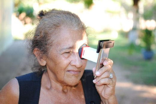 Old Lady using Netra to do an Eye Test
