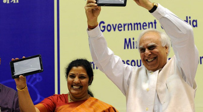 Indian Minister Sibal Displaying the Aakash Tablet