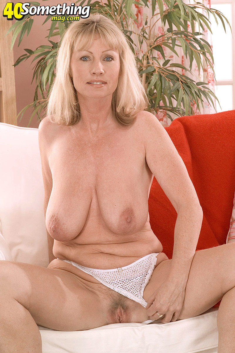 naked mature laying down