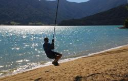 Andrew on a rope swing