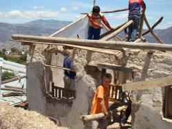 Davy helping out to replace the roof on a tumbledown shack in the Andes
