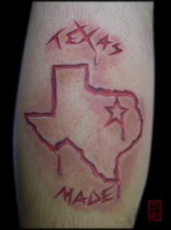 Tattoo of the state of texas looks as though it's carved into the flesh
