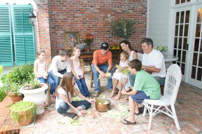 The Harris family enjoying time together on the back porch.