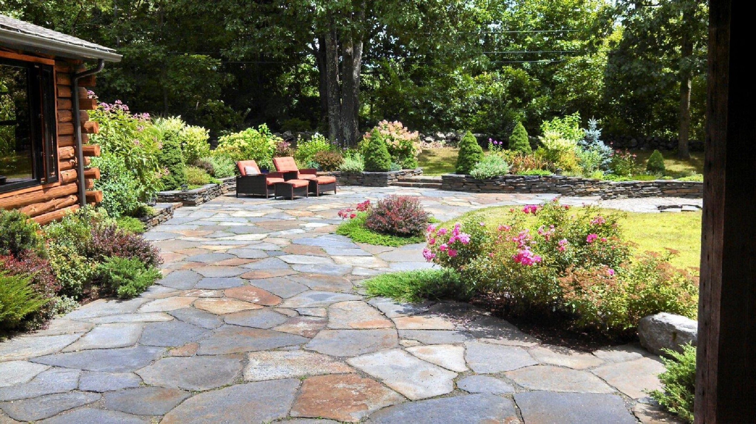The natural look of stone in this goshen stone patio by steven breed garden designs