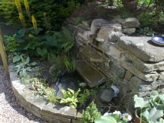 Paving and a natural pond in Bingley