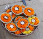India, Varanasi. Marigold votive offerings