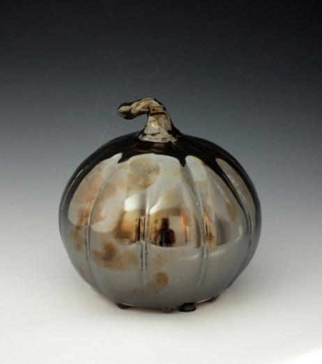 Halloween and Fall lovers will appreciate this metallic surfaced pumpkin.