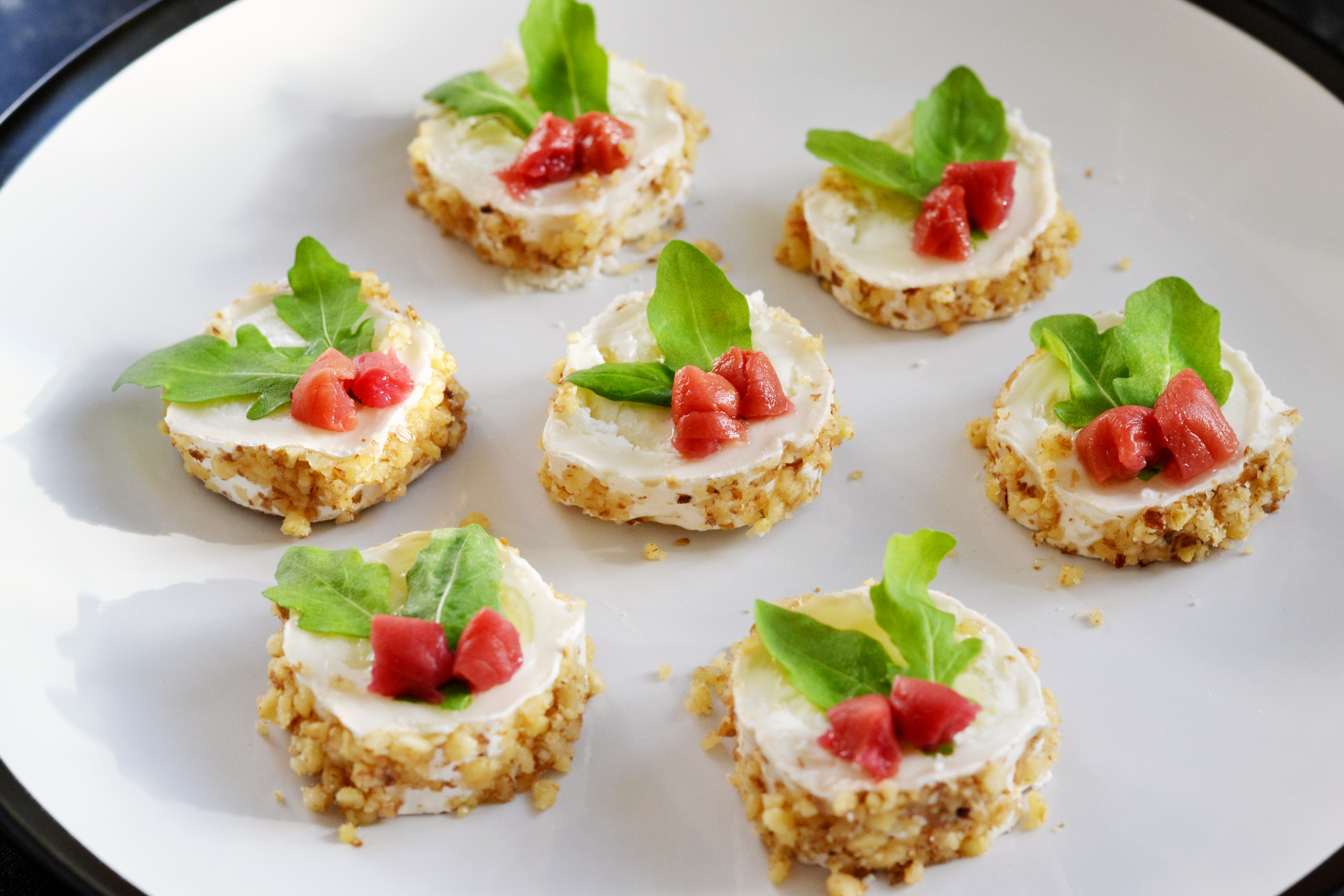 Canapés Goat S Cheese Rounds With Honey Walnut Rocket And Umeboshi