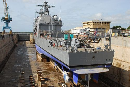 USS Port Royal sits in drydock at the Pearl Harbor Naval Shipyards