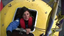 Greenpeace protester boarding the anchor survival pod