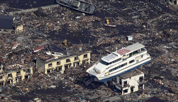 Japan Tsunami - Ferry On Top Of Building