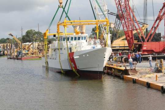 Coast Guard Cutter Bernard C. Webber settles into the water with the rigging attached.  For the first part of the launch the cutter was kept rigged while the an inspection took place.  If everything is satisfactory, the rigging is detached. U.S. Coast Guard photo.