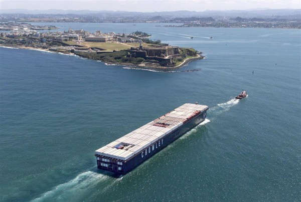 Carriers currently use 17 vessels to provide their shipping services, including 5 self-propelled containerships and 12 container  barges that are pulled by tugboats, with an average 30 years for a containership and about 27 years. Photo courtesy Crowley