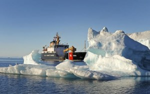 Coast Guard Cutter Willow transits by an iceberg on an Arctic patrol. U.S. Coast Guard photo by Petty Officer 3rd Class Luke Clayton.