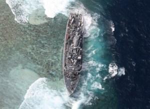 USS Guardian aground on Tubbahata Reef