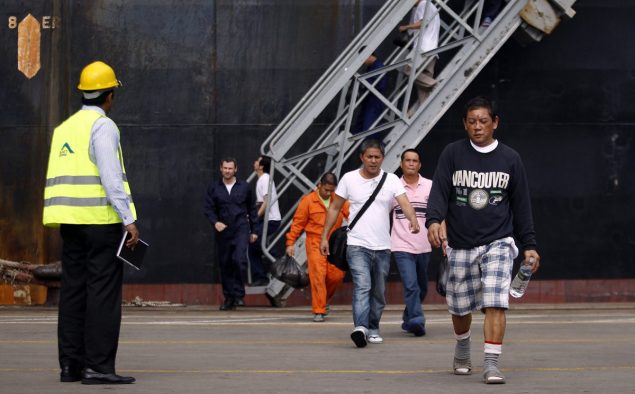 Crew members from Mitsui O.S.K. Lines' MOL Comfort, a container ship that broke into two in the Indian Ocean, disembark from a ship at a port in Colombo June 20, 2013.