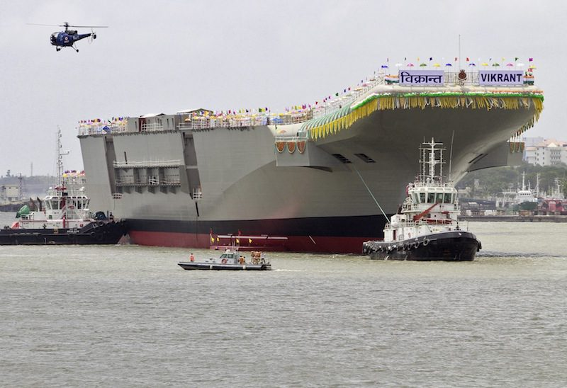 "India's 40,000 tonne indigenous Aircraft Carrier P-71 ""Vikrant"", built for the Indian Navy, leaves Cochin Shipyard after its launch in the southern Indian city of Kochi August 12, 2013. REUTERS/Sivaram V"