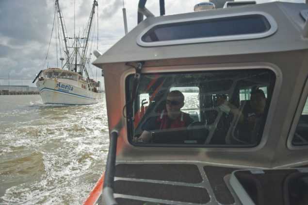 A boat crew from Coast Guard Station South Padre Island, Texas, escorts Mexican shrimp boats leaving the port of Brownsville after seeking shelter from Hurricane Ingrid. U.S. Coast Guard photo.  0 - See more at: http://coastguard.dodlive.mil/2013/10/safe-haven-from-hurricane-ingrid/1026746-1024x681/#sthash.uiYrgGvi.dpuf