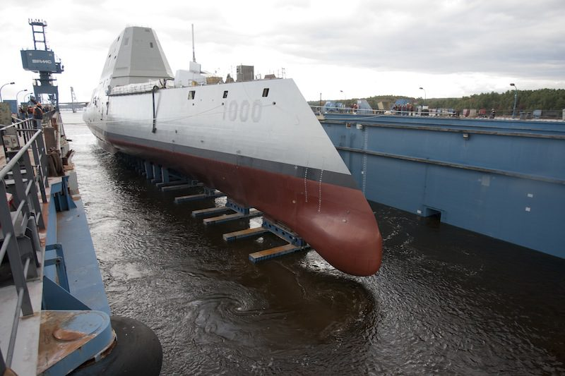 he Zumwalt-class guided-missile destroyer DDG 1000 is floated out of dry dock at the General Dynamics Bath Iron Works shipyard in October 2013. U.S. Navy Photo