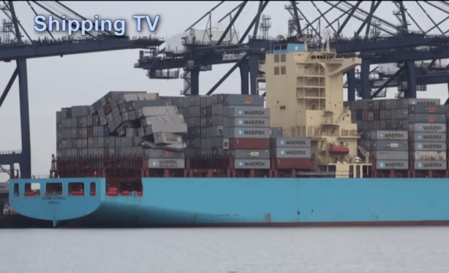 Screengrab from the video below showing toppled containers.
