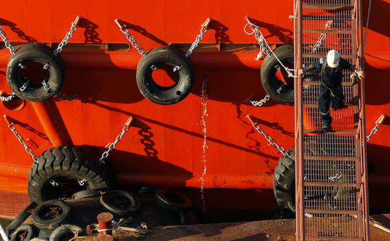 A worker disembarks a ship at a shipyard in Singapore July 10, 2013.