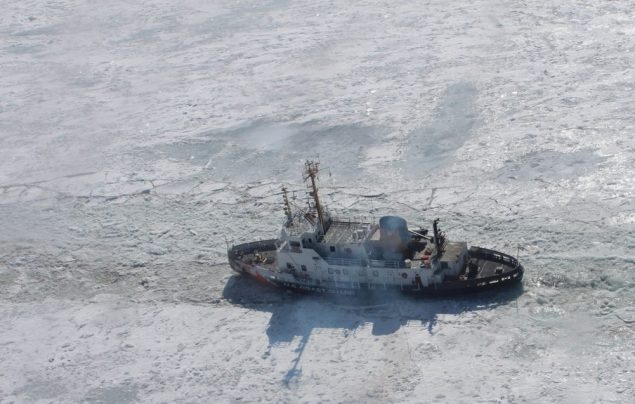 The crew of Coast Guard Cutter Neah Bay, a 140-foot ice-breaking tug homported in Cleveland, breaks through the ice in the St. Clair River, Feb. 26, 2014. U.S. Coast Guard Photo