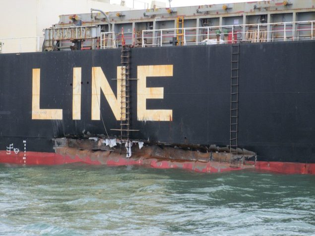 Damage to the cargo ship Genius Star VII can be seen after a barge carrying 840,000 gallons of fuel oil collided with it in the Houston Ship Channel, March 15, 2014. There were no pollution or injuries associated with the collision. U.S. Coast Guard photo.