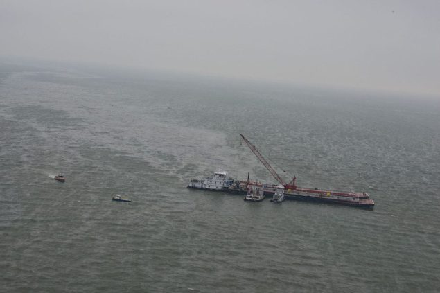 A barge leaks oil into the Gulf of Mexico outside the Houston Ship Channel following a collision with a carrier, March 23, 2014. U.S. Coast Guard Photo
