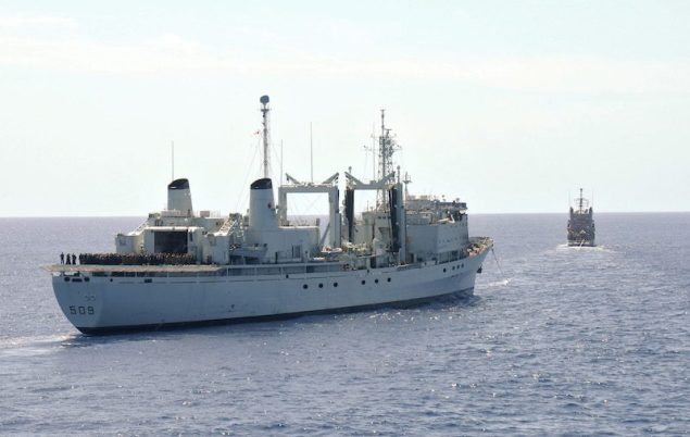 HMCS Protecteur under tow by the Military Sealift Command fleet ocean tug USNS Sioux (T-ATF 171). U.S. Navy Photo