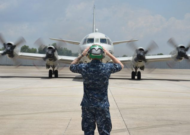 A Sailor assigned to Patrol Squadron (VP) 46 prepares to launch a P-3C Orion before its mission to assist in search and rescue operations for Malaysia Airlines flight MH370, March 17, 2014. U.S. Navy Photo