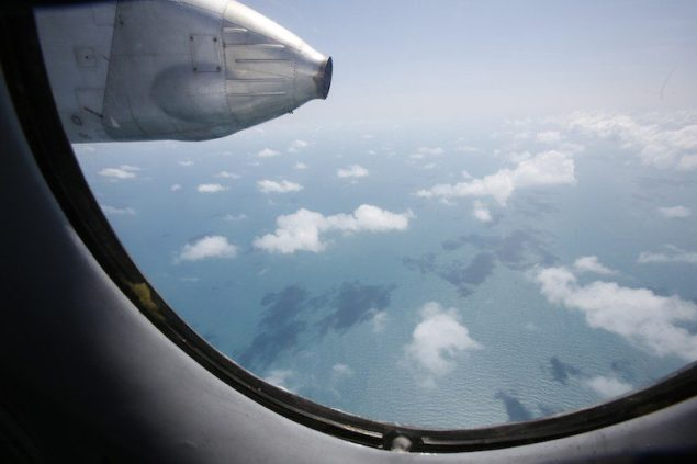 Clouds hover outside the window of a Vietnam Air Force search and rescue aircraft An-26 on a mission to find the missing Malaysia Airlines flight MH370, off Vietnam's Tho Chu island March 10, 2014. © 2014 Thomson Reuters. All rights reserved.