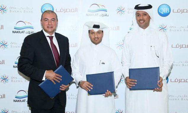 L-R: Bassel Gamal, QIB Group CEO, Eng. Abdullah Fadhalah Al Sulaiti, Managing Director of Nakilat, Khalid Al Subeai, Acting Chief Executive Officer of Barwa Bank