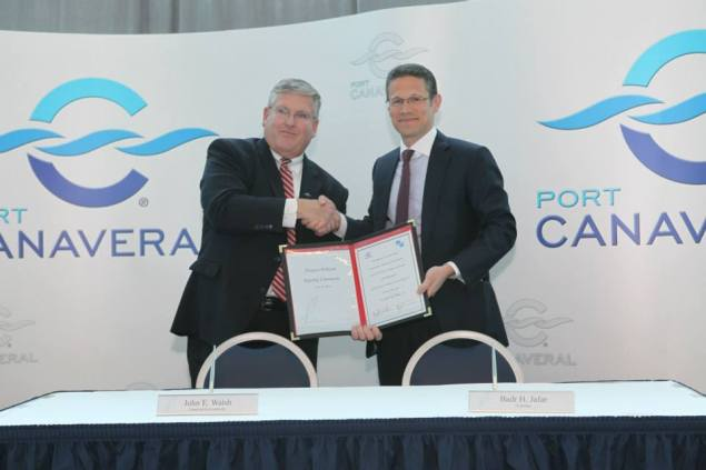 John Walsh, CEO of the Canaveral Port Authority and Badr Jafar, Chairman of Gulftainer's Executive Board shake hands after signing the contract. Photo courtesy Port Canaveral/Facebook