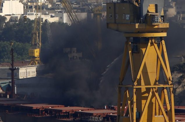 Thick black smoke rises from the deck of the Liberia-registered bulk carrier Cape Tavor at the Palumbo dockyard in Valletta's Grand Harbour