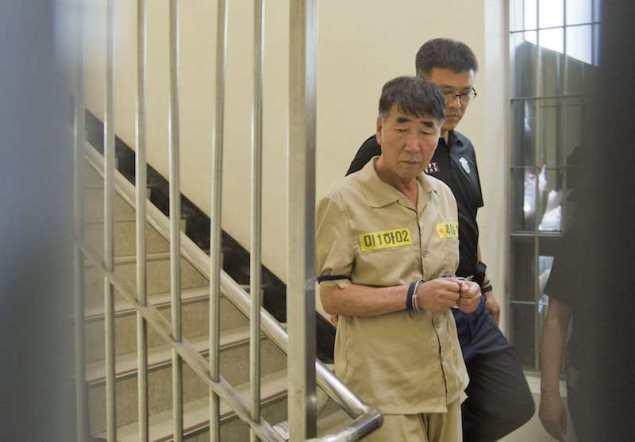 Lee Joon-seok, captain of sunken ferry Sewol, arrives at a court in Gwangju June 10, 2014. REUTERS/Korea Pool/Yonhap