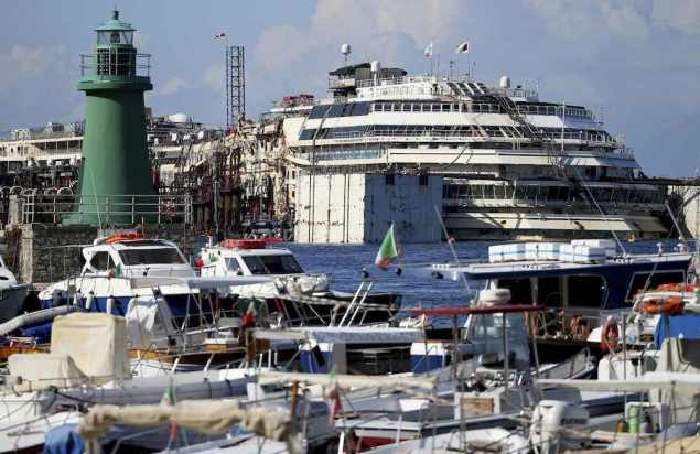 The cruise liner Costa Concordia is seen in front of at Giglio harbour, Giglio Island July 13, 2014, just prior to the refloating and tow operations. REUTERS/Alessandro Bianchi