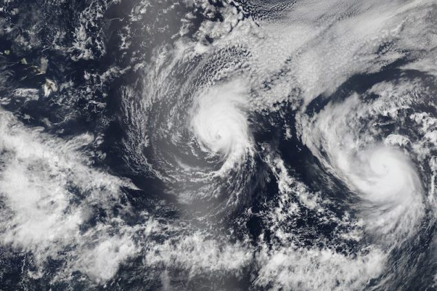Hurricane Iselle and Hurricane Julio (R) are pictured en route to Hawaii in this August 5, 2014 NASA handout satellite image. Hurricane Iselle is expected to make landfall on Hawaii August 7, 2014.  REUTERS/NASA/Handout via Reuters  (UNITED STATES - Tags: ENVIRONMENT) THIS IMAGE HAS BEEN SUPPLIED BY A THIRD PARTY. IT IS DISTRIBUTED, EXACTLY AS RECEIVED BY REUTERS, AS A SERVICE TO CLIENTS. FOR EDITORIAL USE ONLY. NOT FOR SALE FOR MARKETING OR ADVERTISING CAMPAIGNS