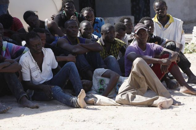 African migrants rest after being rescued by the Libyan coastguard after their boat sunk off the coastal town of Garaboly, east of Tripoli, September 15, 2014. According to a coastguard spokesperson, there were 108 immigrants on the boat, of which 102 were rescued while three were found dead and another 3 missing. REUTERS/Ismail Zitouny
