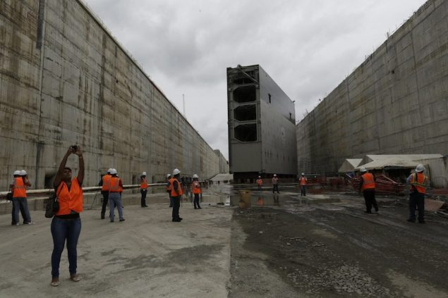 Members of the media are seen by a rolling gate at the construction site of the Panama Canal expansion project on the Atlantic side in Colon City September 7, 2014.