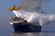 Watch: Water-Bombing Plane Fights Ship Fire from Air
