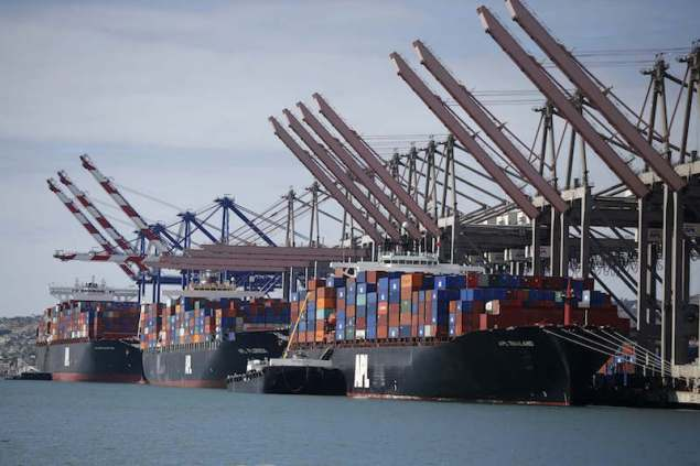 Container ships sit in berths at the Port of Los Angeles, California October 15, 2014. REUTERS/Lucy Nicholson