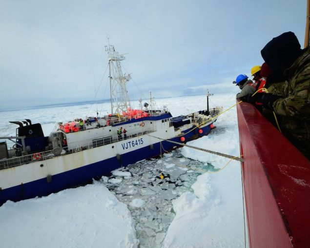 Members of the military dive team aboard Coast Guard Cutter Polar Star launch a remote operated vehicle into the water to inspect the disabled fishing vessel Antarctic Chieftain, beset by ice near Cape Burks, Antarctica, Feb. 14, 2015. U.S. Coast Guard Photo