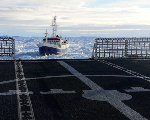 The disabled fishing vessel Antarctic Chieftain is towed astern of the Coast Guard Cutter Polar Star through sea ice near Antarctica, Feb. 14, 2015. U.S. Coast Guard Photo