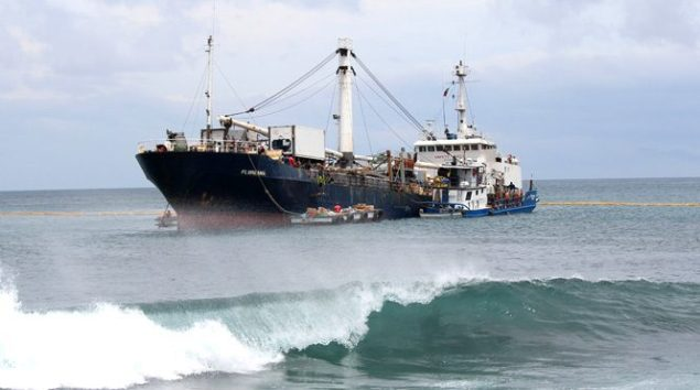 The MV Floreana aground  in the bay of Puerto Baquerizo Moreno off the coast of San Cristóbal. Photo courtesy COE