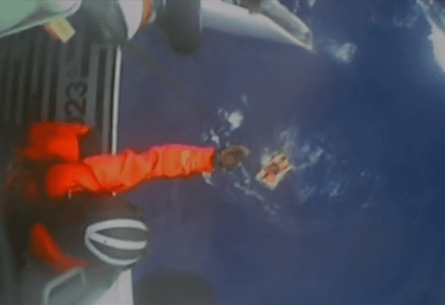 A screenshot of U.S. Coast Guard video showing the rescue of five people Friday, Jan. 30, 2015, from a sailboat after the sailboat's mast broke approximately 200 miles off the coast of North Carolina.