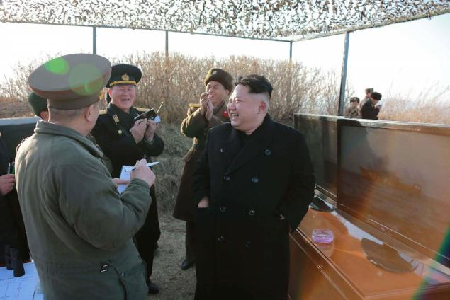 North Korean leader Kim Jong Un speaks to officials as he watches the test-firing of a new type of anti-ship cruise missile to be equipped at Korean People's Army (KPA) naval units in this undated photo released by North Korea's Korean Central News Agency (KCNA) in Pyongyang February 7, 2015. REUTERS/KCNA