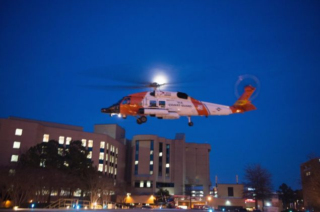 A Coast Guard MH-60 Jayhawk helicopter crew lands at Sentara Norfolk General Hospital in Norfolk, Va., Thursday, April 2, 2015, after medevacing a sailor who had been missing for more than 60 days. U.S. Coast Guard Photo