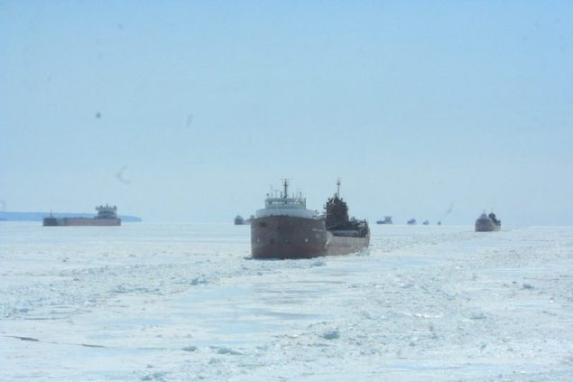 Vessels carrying commodities to and from ports throughout the Great Lakes wait on eastern Lake Superior while U.S. and Canadian Coast Guard ice breakers create tracks for the vessels to continue transiting April 7, 2015. U.S. Coast Guard Photo