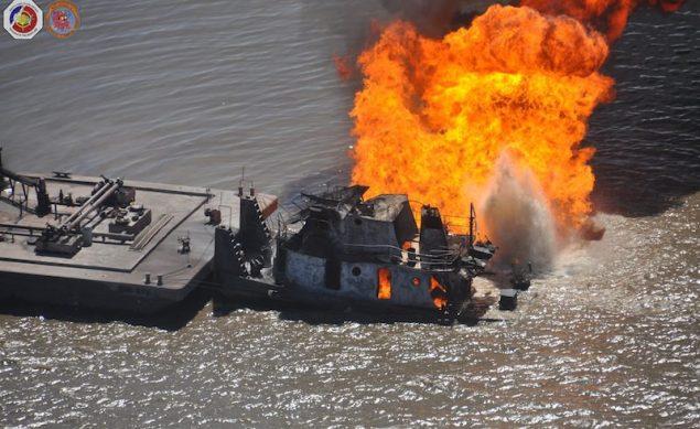 The tug Shanon E. Settoon ablaze near Bayou Perot, 30 miles south of New Orleans, March 13, 2013. U.S. Coast Guard Photo