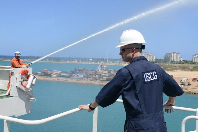 Petty Officer 1st Class Gary Bullock, a port state control officer at Coast Guard Sector Honolulu Prevention, observes crew members demonstrating firefighting capabilities aboard the 600-foot Panamanian flagged bulk freight ship, Teizan, at Kalaeloa Barbers Point Harbor, May 19, 2015. Coast Guard crew members conduct inspections to ensure a vessel has a suitable structure, correct documentation, proper working equipment and lifesaving equipment and adequate accommodations. (U.S. Coast Guard photo by Petty Officer 2nd Class Tara Molle)